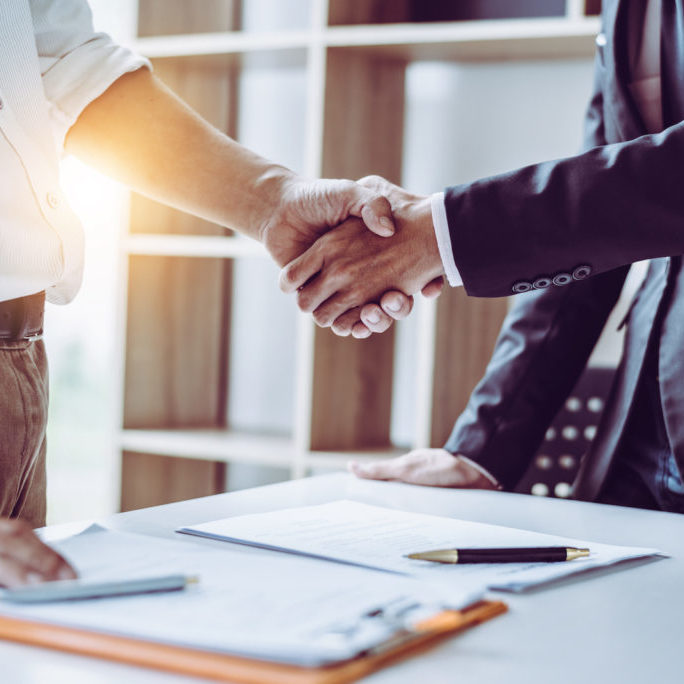 Attorneys shaking hands about a law firm website design
