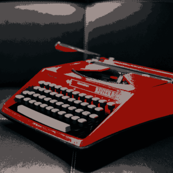 This is a red typewriter.