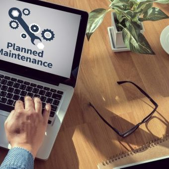 Laptop showing website maintenance service